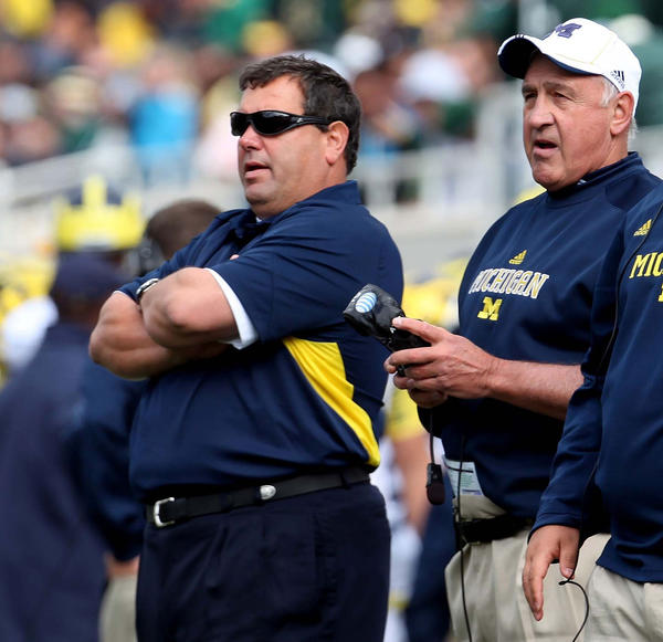 Michigan head coach Brady Hoke (left) and defensive coach Greg Madison watch during the fourth quarter against Michigan State last season.