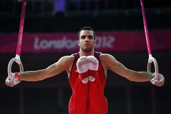 U.S. gymnast Danell Leyva works out during a training session Wednesday at the North Greenwich Arena in London before the Olympics start.