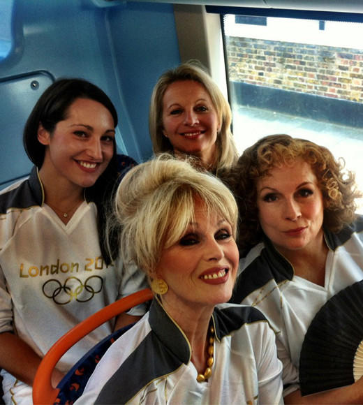 Jennifer Saunders and Joanna Lumluy on my torchbearing bus! Amazing! #torchrelay #Olympics <i>-- @EmilyJG</i>