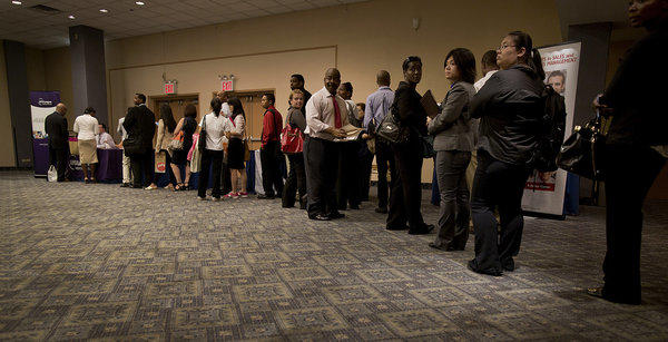 Job seekers wait in line to talk to recruiters at a Choice Career Fair in New York.