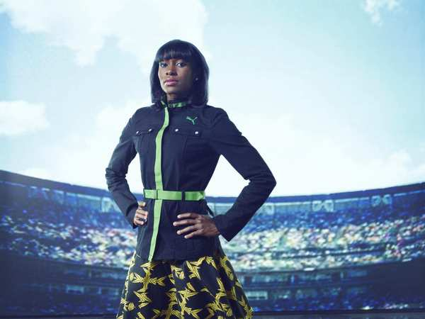 Shevon Stoddart, a hurdler for Jamaica, shows off the military-influenced jacket and leaf-print skirt designed by Cedella Marley for Puma for the Opening Ceremonies. Cedella Marley, eldest daughter of the late Bob Marley, partnered with Puma to create the team look.
