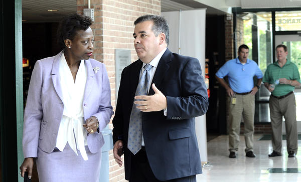 Washington County Public Schools Superintendent Clayton Wilcox talks Thursday with Maryland State Superintendent of Schools Lillian M. Lowery during her visit to the Educator Effectiveness Academy held at South Hagerstown High School.