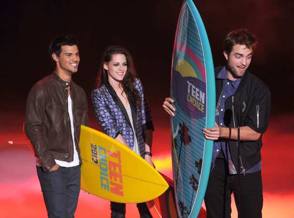 """The Twilight Saga"" continues its long road to retirement as Taylor, Kristen and Robert appear at the 2012 Teen Choice awards to collect trophies. Two days after the ceremony, Stewart's romantic outing with ""Snow White and The Huntsman"" director Rupert Sanders would be revealed."