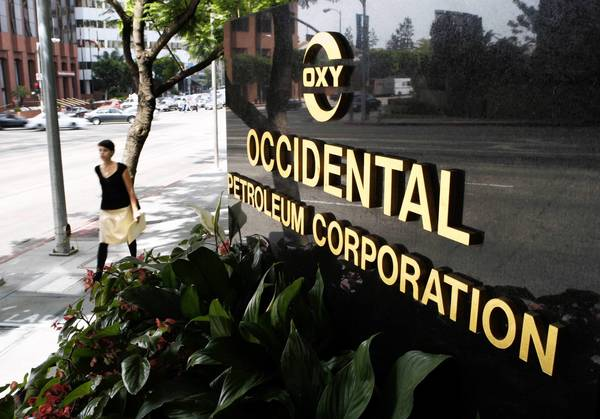 """We expect to do more with less money in the rest of the year,"" Occidental Chief Executive Stephen I. Chazen says. The Westwood-based oil company posted second-quarter net income nearly 28% lower than last year."