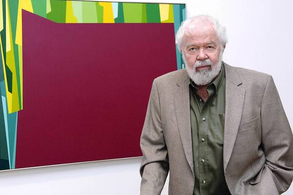 "Karl Benjamin with his ""Interlocking Forms (Big Magenta With Green), 1959,"" at an exhibit opening in 2007."