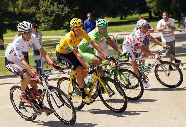 U.S. cyclist Tejay van Garderen, left; winner Bradley Wiggins in the yellow jersey; Peter Sagan of Slovakia; and Thomas Voeckler of France pose during the final stage of the 2012 Tour de France.