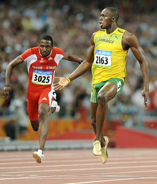 Jamaica's Usain Bolt cruises to a world record in the 100 meters over runner-up Richard Thompson of Trinidad at the 2008 Beijing Olympics.