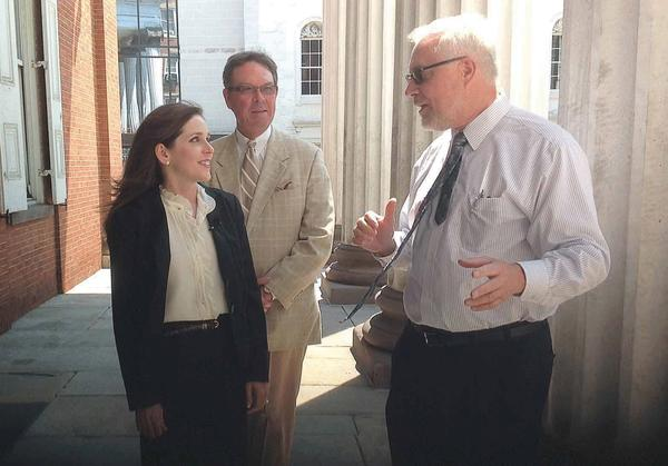 Pennsylvania treasurer candidate Diana Irey Vaughan talks with Franklin County Treasurer Dave Secor and Franklin County Commissioner Bob Thomas, right, in Chambersburg, Pa., on Thursday.