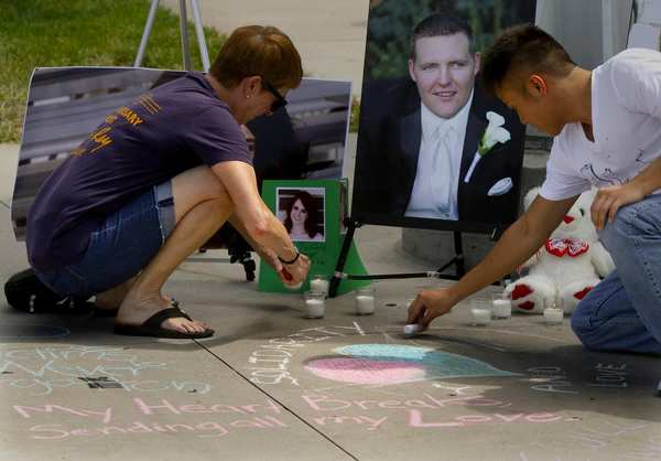 DENVER,COLORADO, JULY 26, 2012: Students and faculty join together at the University of Colorado Denver Auraria campus to honor the shooting victims in Aurora, Colo., with prayer, chalk drawings and a small memorial.