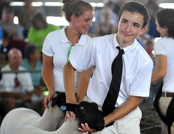 Tyler Poffenberger leads his market lamb around the ring Thursday during the Washington County 4-H and Future Farmers of America Market Animal Sale at the Washington County Agricultural Education Center near Sharpsburg.