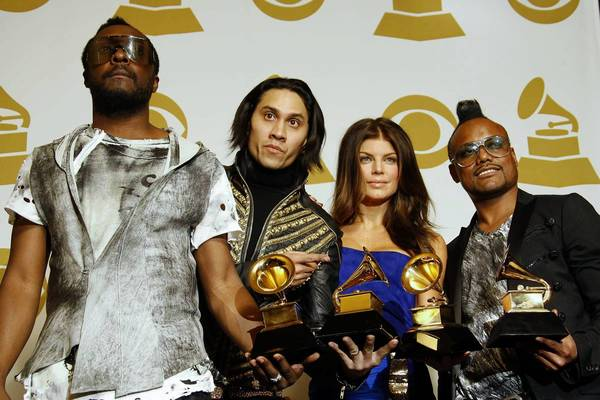 The Black Eyed Peas attend the 52nd annual Grammy Awards in 2010. Three members of the band -- will.i.am, left; Taboo, second from left; and apl.de.ap, right -- have filed a federal lawsuit against their former business manager, Sean M. Larkin. Band member Fergie, second from right, is not involved in the lawsuit.