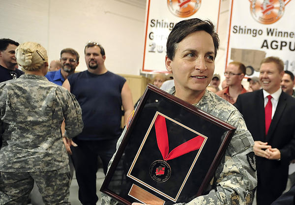 In this Herald-Mail file photo, Letterkenny Army Depot Commander Col. Cheri A. Provancha holds the Shingo prize for Excellence in Manufacturing bronze medallion. U.S. Sen. Bob Casey announced concerns Thursday about a defense bill passed by the House of Representatives that includes a provision he says could prompt layoffs at Letterkenny Army Depot north of Chambersburg.