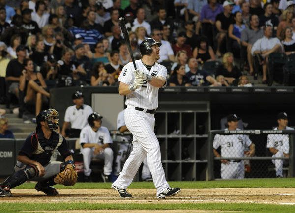 Adam Dunn hits a two-run homer in the third inning against the Twins.
