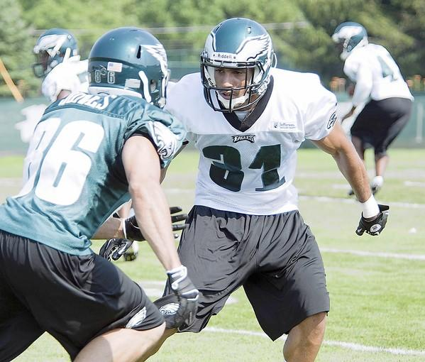Philadelphia Eagles defensive back Curtis Marsh (31) covers Tiger Jones (86) as the full team gathers for practice during training camp at Lehigh University on Thursday.