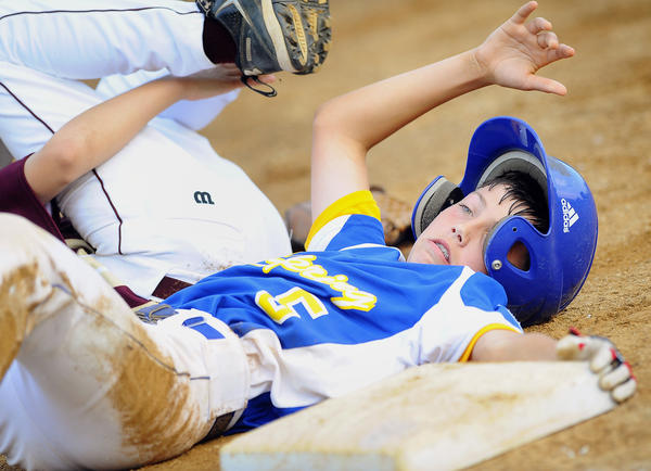 Clear Spring's Joe Micco is safe at third base in the third inning of Thursday night's losers' bracket final against Brunswick in the Maryland 11-12 Little League state tournament at Brunswick, Md.