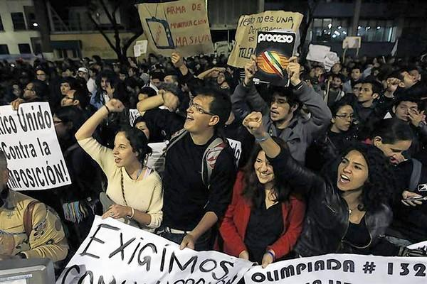 "Protesters take part in a 'symbolic blockade' in front of broadcaster Televisa organized by student movement ""Yo Soy 132"" against Mexico's president-elect Enrique Pena Nieto in Mexico City"