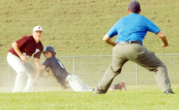 Petoskey's Kenny Gray (right) and Parchment shortstop look to the umpire for the call after Gray's dive into second base Thursday during a Little League Senior Division State Tournament game at the Petoskey Middle School field.