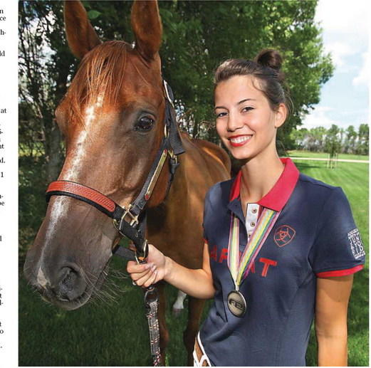 Northern State student Kelsey Kimbler of Aberdeen and her Arabian horse Fringant recently won a silver medal at a prestigious 75-mile race in Kentucky. American News Photo by John Davis