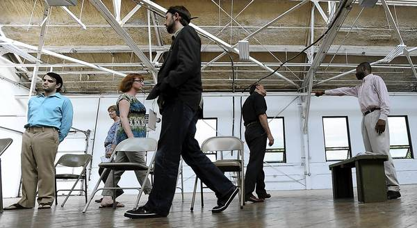 Roy Shuler portraying Delbert (right), rehearses with the cast of the Allentown Public Theatre production of 'The Exonerated.' .