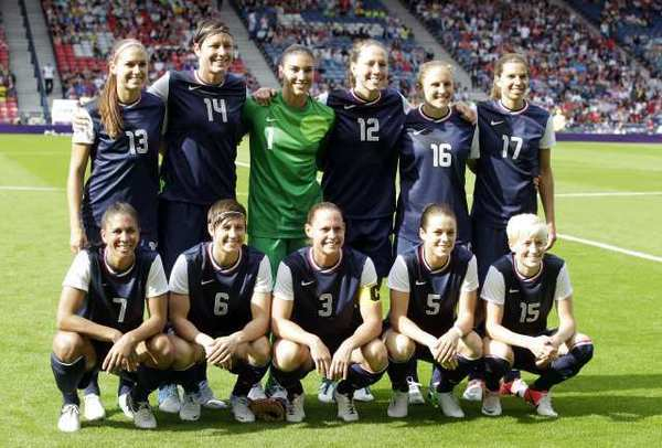 Members of the U.S. women's Olympic soccer team pose for a group photo before taking on France in their 2012 group play opener on Wednesday in Glasgow, Scotland, a 4-2 U.S. win.