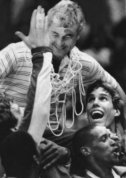 Bob Knight coached the gold medal-winning Olympic basketball team in 1984, making him one of three basketball coaches to claim an NCAA title, NIT title and Olympic gold medal.   Knight is now an ESPN college basketball analyst after many years of coaching college basketball, most of them at Indiana University.