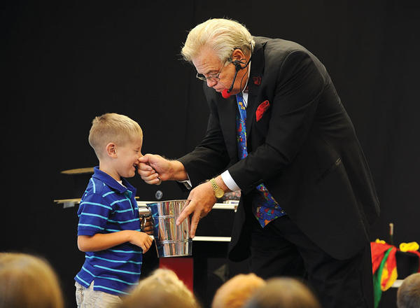 Magician Doug Doolin kept finding coins in the nose of William Davis, 5, during his magic show during the Clark County Public Library¿s Summer Reading Program, top photo. Paxton Harper, 5, right, playing the wolf in ¿The Three Little Pigs,¿ huffed and puffed put he couldn¿t blow down their house during a magic trick, above left photo. Playing the three little pigs are, foreground, Laney Frazier, 4, Makayla Carpenter, 8, and Bethany Mohr, 10. Clay Comer, 10, had a look of shock on his face when Doolin dumped a raw egg on his head, above right photo. Somehow, magically, the raw egg became a boiled egg during the trick. The reading program ends today.  The store hours for children to claim their prizes will be from 1 to 4 p.m. Saturday, 5 to 7 p.m. Monday and 9 a.m. to 8 p.m. Tuesday.
