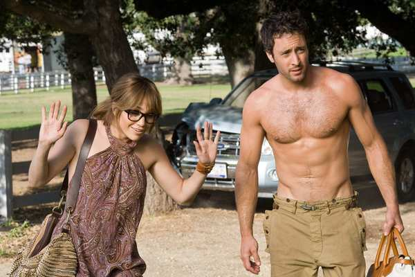 """Hawaii Five-0"" star O'Loughlin is Stan, with Jennifer Lopez as Zoe, in ""The Back-up Plan."" Look to your left, Jennifer, look to your left!"