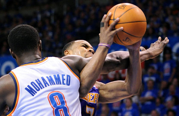 Nazr Mohammed defends against Laker Ramon Sessions in May.