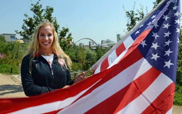 U.S. flag bearer Mariel Zagunis.