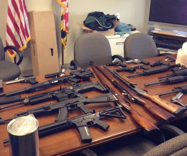 Guns seized in raid.