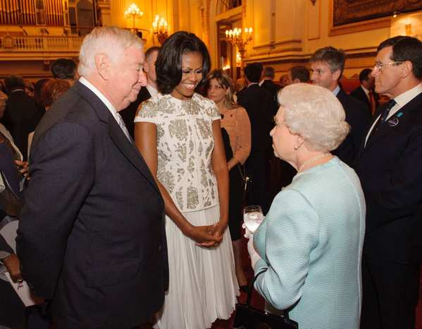 Queen Elizabeth chats with First Lady Michelle Obama and U.S. Ambassador to Britain Louis Susman at a Buckingham Palace reception for heads of state and other visiting dignitaries before the opening ceremony.