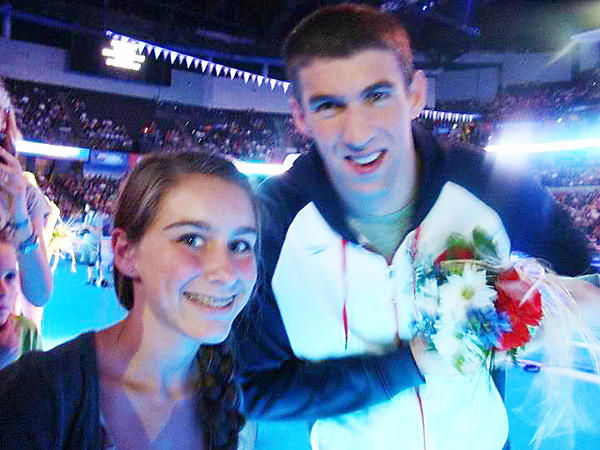 Charlevoix's Ali Schwein (left) has pauses for a photo with U.S. Olympic swimmer Michael Phelps during the Team U.S. swimming trials in June.