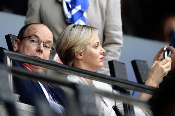 Prince Albert II of Monaco and Princess Charlene of Monaco enjoy the atmosphere before the ceremonies.