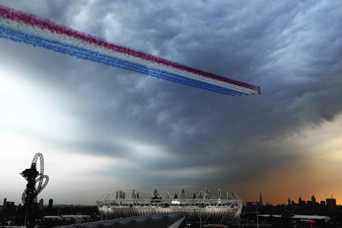 The Red Arrows, the Royal Air Force aerobatic team, fly over Olympic Park.