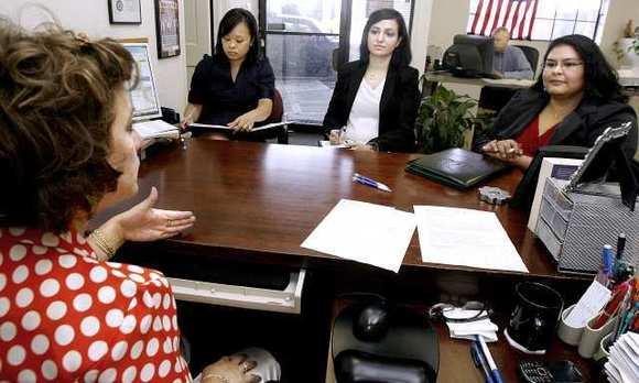 Nancy Guillen of True Integrity Insurance, left, consults with Woodbury University MBA students, Frances Fogg, second from left, Dania Nalbandian, second from right, and Jessica Marroquin, right, on how to grow her business.