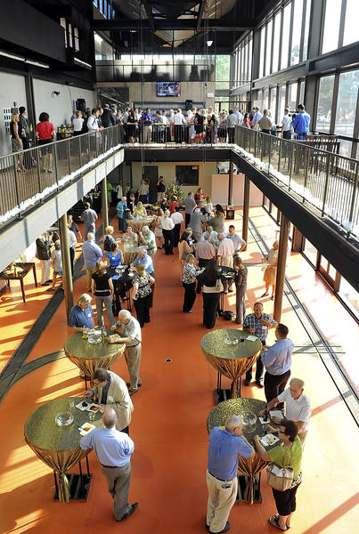 The area that once housed the presses in The Herald-Mail newsroom has been renovated. On July 19, guests attending a Hagerstown-Washington County Chamber of Commerce mixer mingled in the former press room.