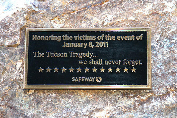 A plaque honoring the victims of the Tucson shooting adorns a rock in the Safeway parking lot where Jared Loughner is accused of shooting Rep. Gabrielle Giffords and 18 others Jan. 8, 2011.