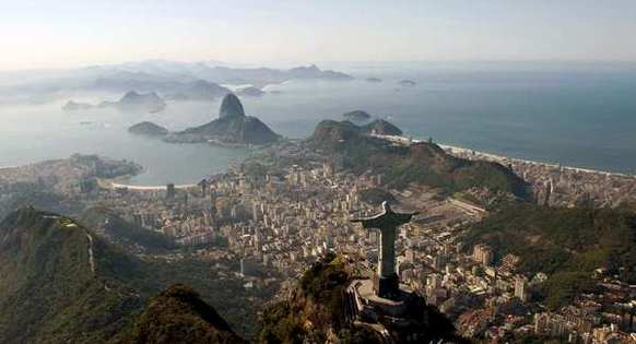 A gigantic statue  of Christ the Redeemer overlooks Rio de Janeiro from atop Corcovado mountain. It's one of the Brazilian city's best-known landmarks.