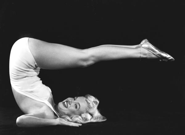 Marilyn Monroe in a yoga pose.
