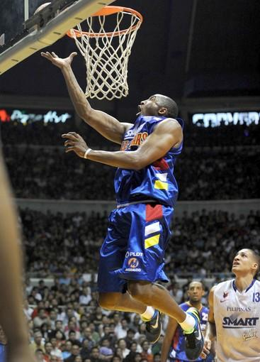 Kobe Bryant tries to make a basket while playing in an exhibition game against professional players from the Philippines in July, 2011. Bryant shot down speculation that he might play in Turkey if the NBA lockout extends into the season.