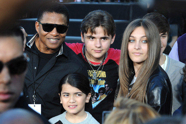 Michael Jackson's children took to Twitter this week. In January: Prince, center, Paris and Blanket, front, with Uncle Tito.
