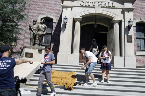 Enrico Silva, 17, from second left, Igor Starodubsev, 17, and Yasmine Hammoudi, 17, prepare for a scene during a New York Film Academy summer workshop at Universal Studios' back lot in Studio City on Friday, July 27, 2012.
