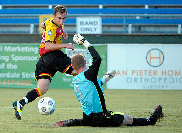 Fort Lauderdale Strikers Mark Anderson gets the ball past Atlanta Silverbacks goalie Daniel Illyes during the first half of their NASL soccer game, Friday, July 27, 2012, at Lockhart Stadium.