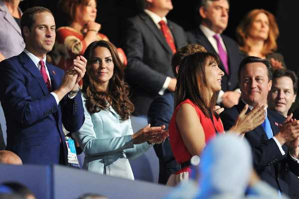 From left, Prince William and his wife, Catherine, Duchess of Cambridge, and Samantha Cameron and Prime Minister David Cameron enjoy the opening ceremony of the London 2012 Olympic Games.