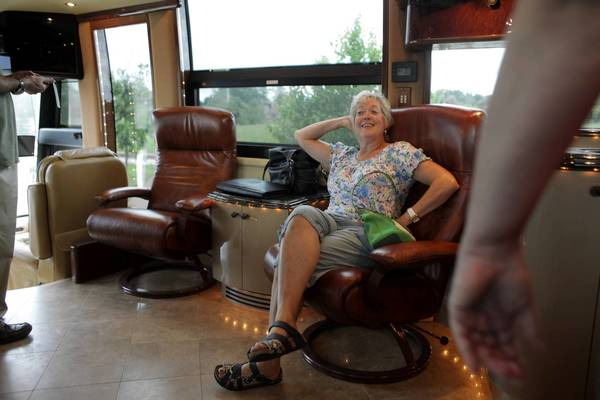 Jeanne Kuhn poses for a picture being taken by a friend in Rita Crundwell's motor home in Oak Creek, Wis. Crundwell's luxury RV is being sold at auction as the former Dixon comptroller faces charges that she stole $53 million from the city.