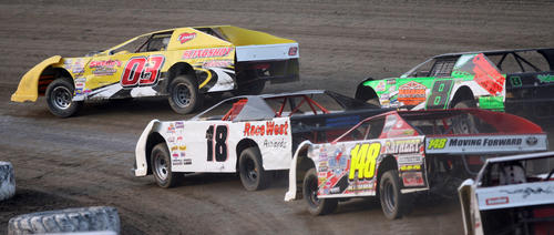 David Thomas, of Claremont (03) leads Carson Gramm, of Ipswich (18), Shawn Malsam (8), of Aberdeen and Eric Krumm, of Aberdeen (148) during the first heat of Superstock action Friday night at the Brown County Speedway. photo by john davis taken 7/27/2012