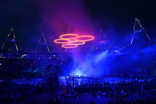 The Olympic rings assemble above the stadium in a scene depicting the Industrial Revolution during the opening ceremony of the London 2012 Olympic Games.