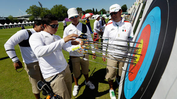 Luis Antonio Alvarez Murillo (far left) checks his arrows during practice