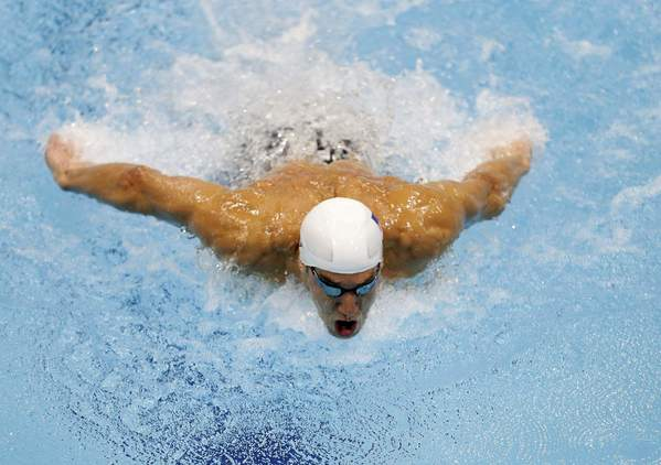Michael Phelps swims during the men's 400m individual medley heats at the London 2012 Olympic Games at the Aquatics Centre.