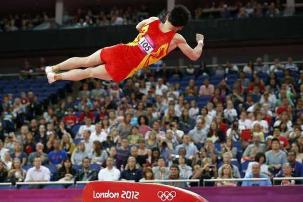 China's Zou Kai competes on the vault.